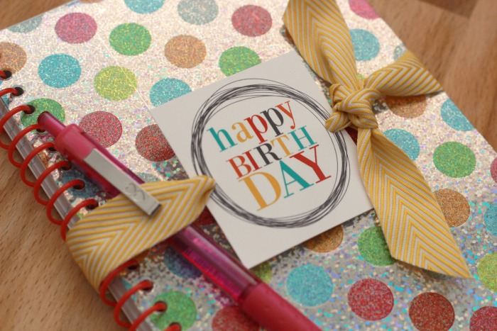 birthday-gift-tags-on-notebook-closeup-1