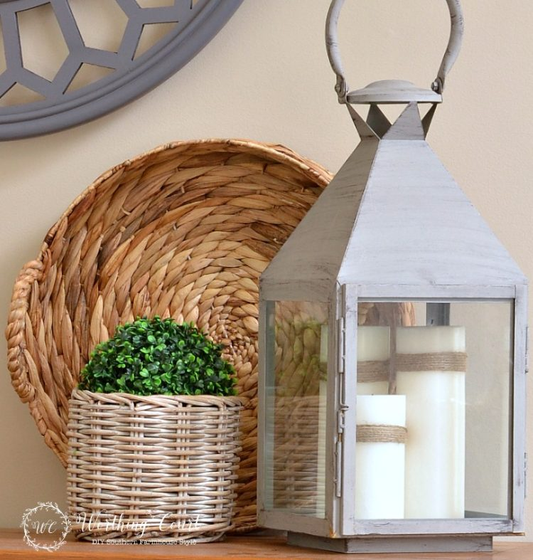 How-To-Decorate-With-Lanterns-tie-twine-around-simple-white-candles-for-added-texture