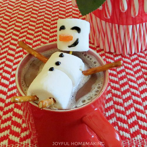 marshmallow snowman in a cup of hot cocoa